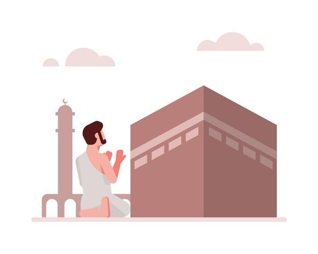 Un uomo musulmano prega davanti ai precedenti dell'illustrazione di kaaba Vettore Premium