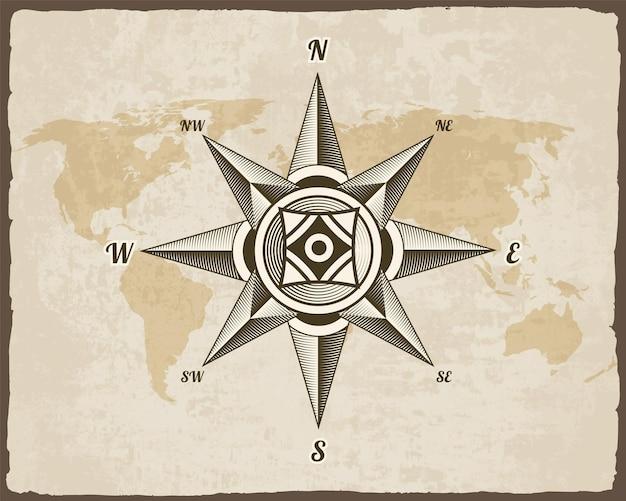 Antico segno nautico bussola sulla vecchia mappa del mondo di carta texture con cornice bordo strappato. Vettore Premium