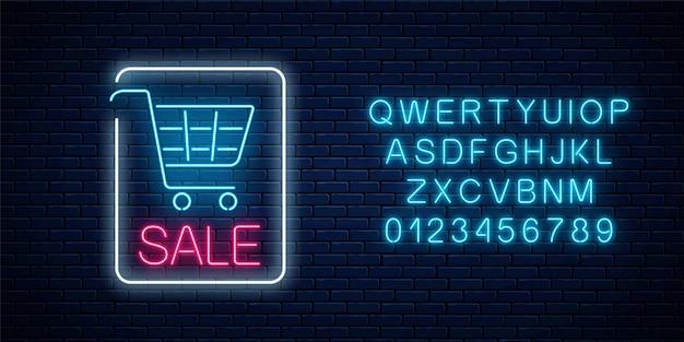 Segno di vendita incandescente al neon con carrello della spesa e alfabeto su uno sfondo di muro di mattoni scuri. banner al neon di grande sconto stagione. Vettore Premium