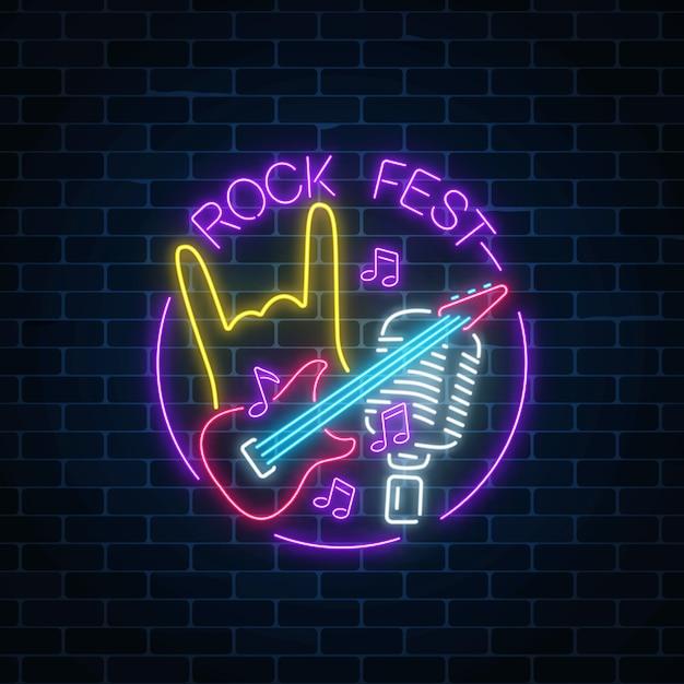 Segno al neon del festival rock con chitarra, microfono e gesto rock in cornice rotonda Vettore Premium