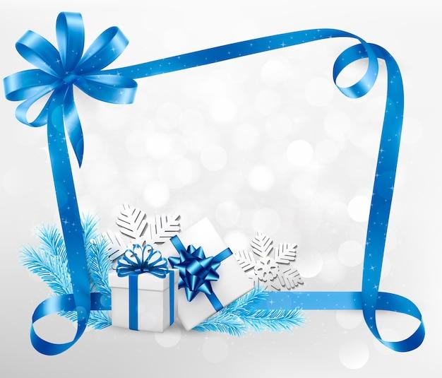 Sfondo di vacanze di natale e capodanno con scatole regalo colorate su un nastro blu. Vettore Premium
