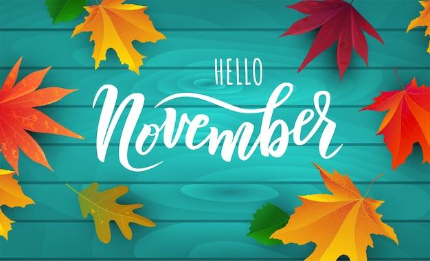 Testo di novembre. tipografia scritta a mano con foglie autunnali luminose. Vettore Premium