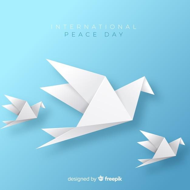 Fondo di giorno di pace di origami con la colomba Vettore Premium