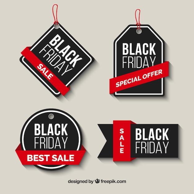 Confezione di vendita nero venerdì etichette con nastri rossi Vettore Premium