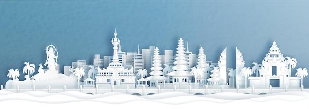 Vista panoramica di denpasar, skyline di bali indonesia con monumenti di fama mondiale dell'indonesia in carta tagliata illustrazione di stile. Vettore Premium