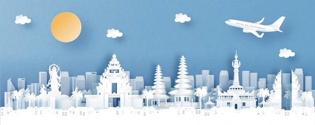Vista panoramica di denpasar, bali. l'indonesia con l'orizzonte del tempio e della città con monumenti di fama mondiale nell'illustrazione di stile del taglio della carta Vettore Premium