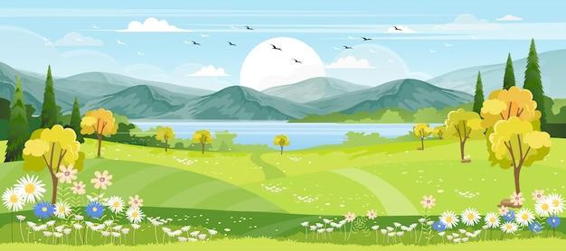 Vista panoramica del villaggio di primavera con prato verde sulle colline con cielo blu Vettore Premium