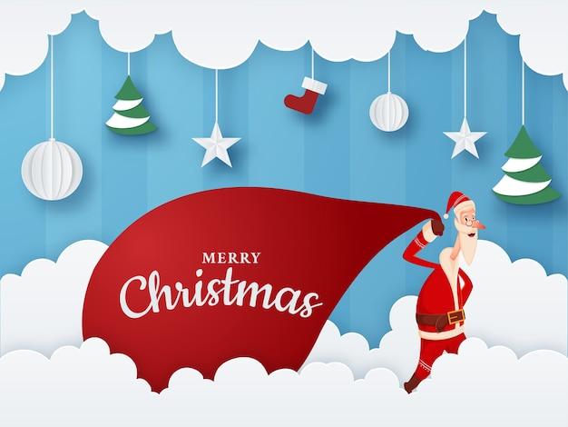 Nuvole tagliate in carta e sfondo a strisce blu decorato con palline da appendere, stelle, calzino, albero di natale e babbo natale che tira un sacco rosso pesante per la celebrazione del buon natale. Vettore Premium