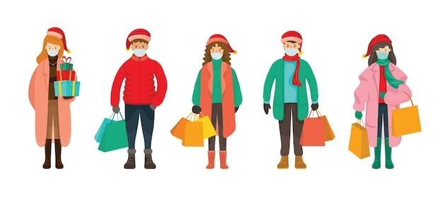 Persone in abiti invernali che indossano la maschera per il viso, concetto di acquisto di natale Vettore Premium