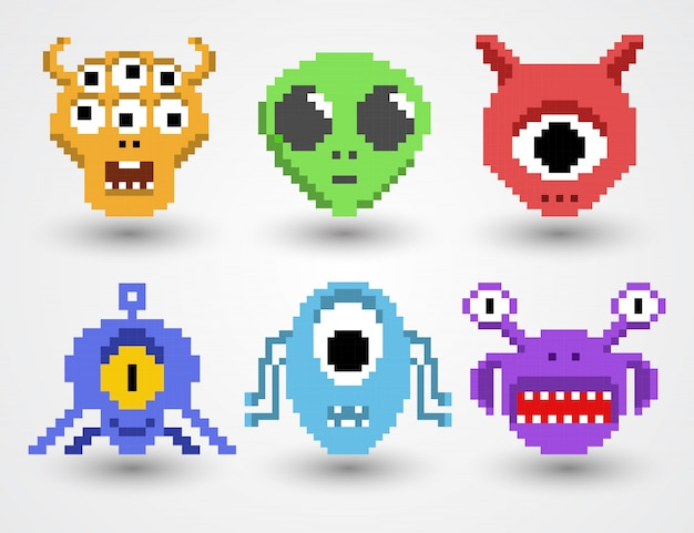 Set di alieni di pixel art Vettore Premium