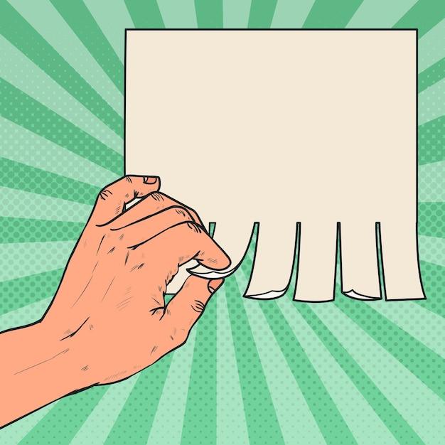 Mano maschile pop art strappare un pezzo di pubblicità in bianco. Vettore Premium