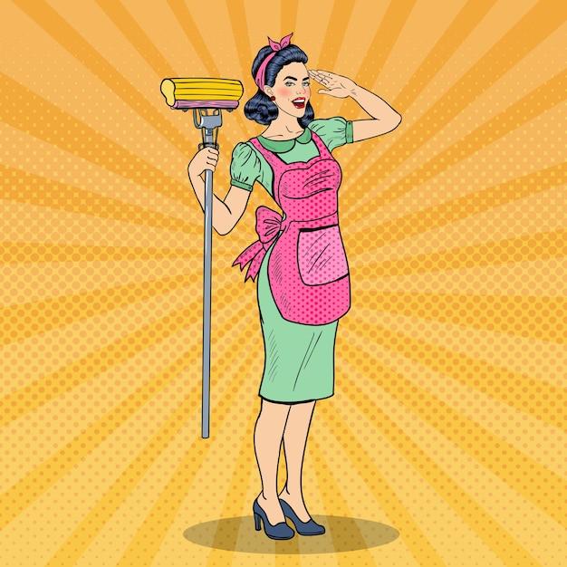 Pop art giovane donna casalinga fiduciosa che pulisce la casa con la scopa. illustrazione Vettore Premium