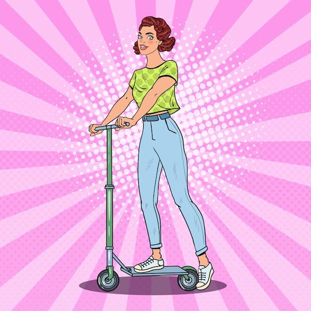 Scooter di guida della ragazza di pop art Vettore Premium