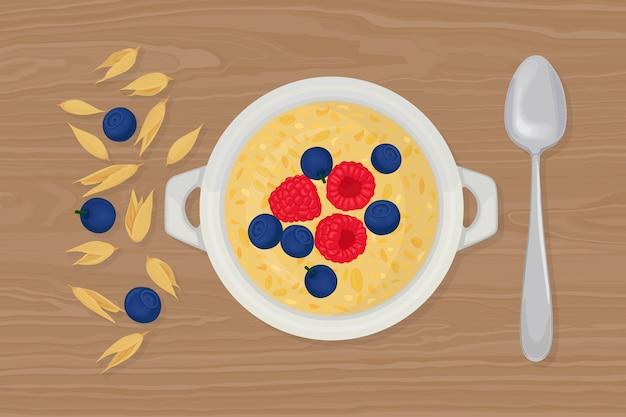Porridge di avena in una ciotola con cucchiaio, bacche, lamponi, noci e cereali su sfondo. colazione salutare Vettore Premium