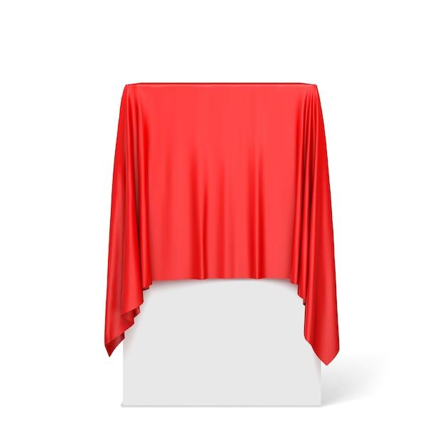 Panno rosso su un piedistallo quadrato isolato su bianco. Vettore Premium