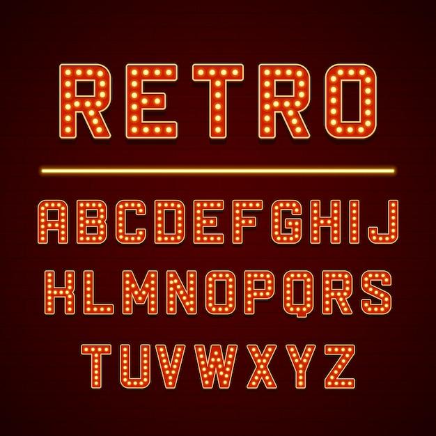 Lettere dell'alfabeto del retro insegna con le lampade delle lampadine Vettore Premium