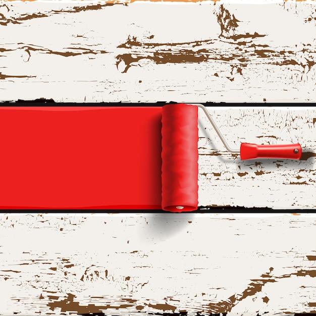 Spazzola a rullo con vernice rossa sul vecchio sfondo di pannelli in legno verniciato Vettore Premium