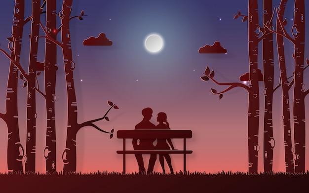 Coppia romantica seduto sulla panchina guardando la luna Vettore Premium