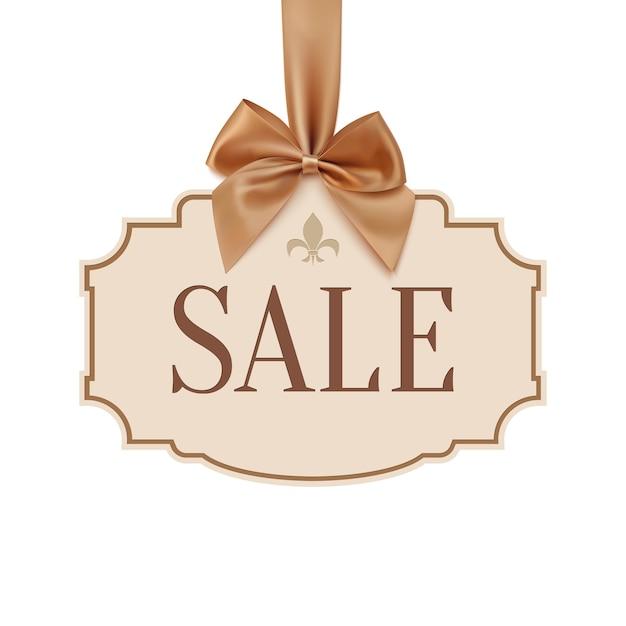 Banner di vendita con nastro dorato e fiocco. Vettore Premium