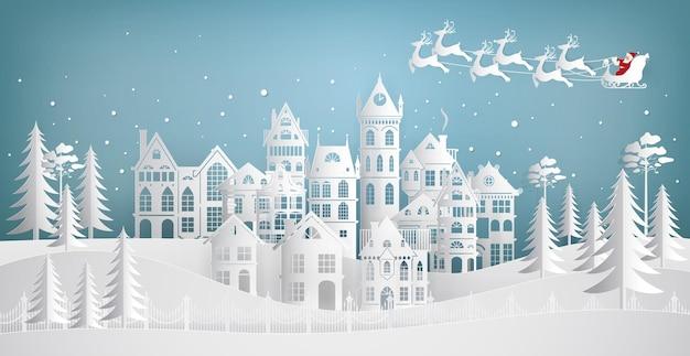 Babbo natale che arriva in città su una slitta con i cervi. buon natale e felice anno nuovo. illustrazione di arte di carta. Vettore Premium