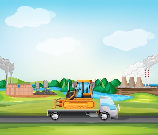 Scena con camion che guida lungo la zona industriale Vettore Premium