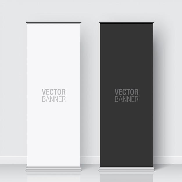 Set di banner rollup bianco e nero in piedi su uno sfondo bianco muro. banner verticale realistico. Vettore Premium