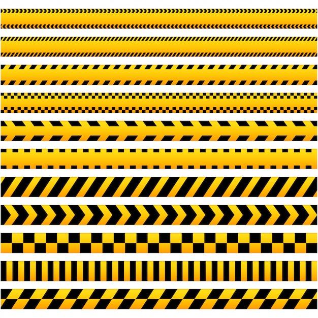 Set di nastri barriera di avvertenza neri e gialli Vettore Premium