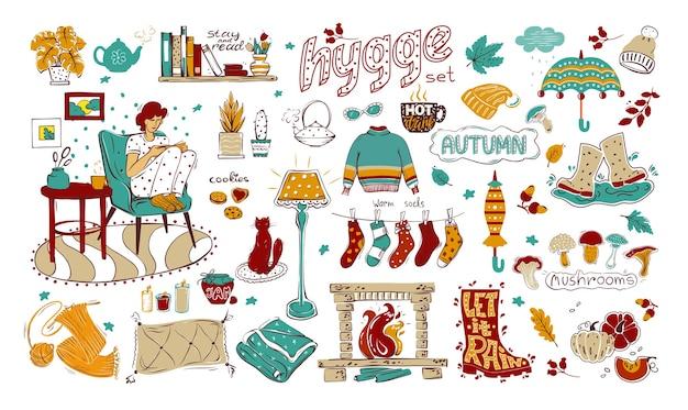 Un insieme di elementi colorati sul tema dell'hygge, dell'autunno e di una casa accogliente. raccolta di elementi di design disegnati a mano isolato su uno sfondo bianco. per il tuo design. Vettore Premium