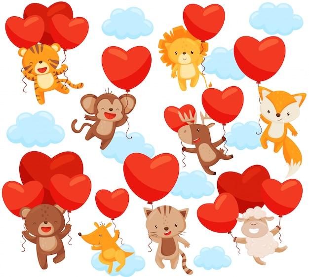Insieme di simpatici animali che volano nel cielo con palloncini a forma di cuore. tema d'amore. elementi per cartolina Vettore Premium
