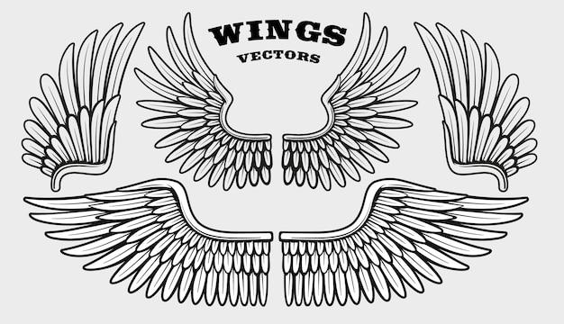 Set di diverse ali bianche e nere Vettore Premium