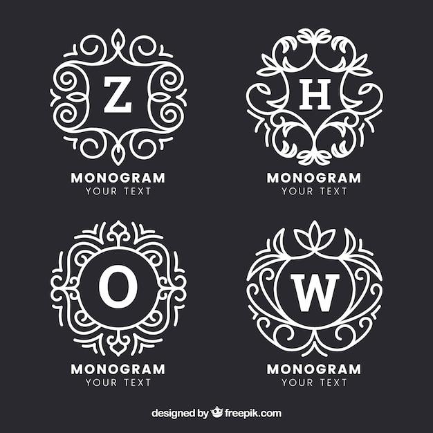 Set di quattro monogrammi disegnati a mano Vettore Premium