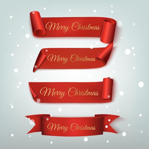 Set di quattro bandiere rosse, buon natale e felice anno nuovo, realistici Vettore Premium