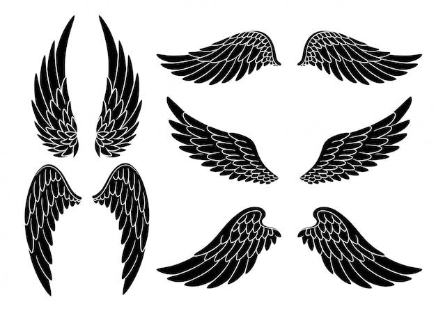 Set di ali di uccello o angelo disegnati a mano di diversa forma in posizione aperta. set di ali di doodle nero Vettore Premium