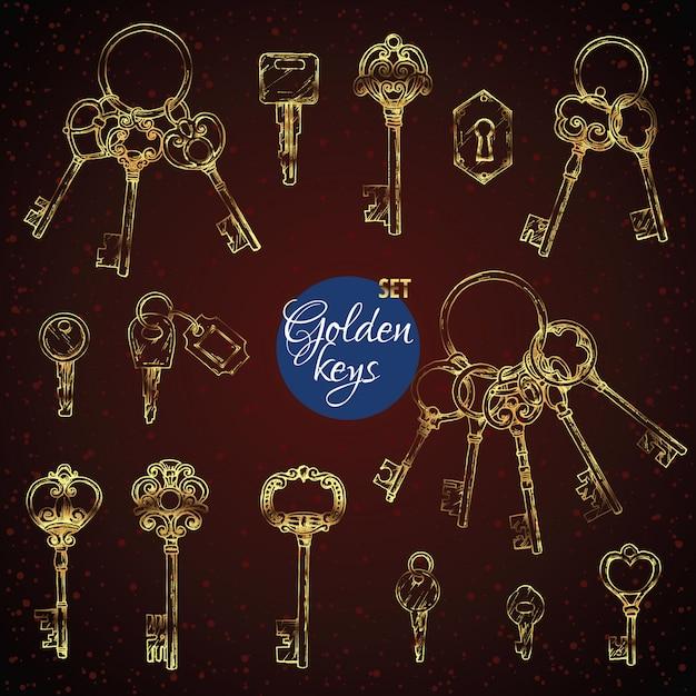 Set di chiavi d'epoca oro disegnati a mano Vettore Premium