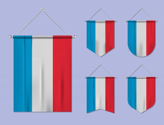 Set di appendere bandiere lussemburgo con trama tessile. forme di diversità del paese di bandiera nazionale. stendardo modello verticale Vettore Premium