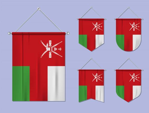 Set di bandiere sospese oman con trama tessile. forme di diversità del paese di bandiera nazionale. stendardo modello verticale. Vettore Premium