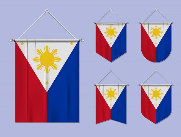 Set di appendere bandiere filippine con trama tessile. forme di diversità del paese di bandiera nazionale. stendardo modello verticale. Vettore Premium