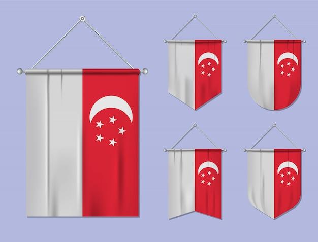 Set di appendere bandiere singapore con trama tessile. forme di diversità del paese di bandiera nazionale. stendardo modello verticale. Vettore Premium