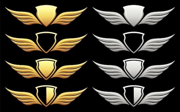 Set di scudo araldico con ali sul nero Vettore Premium