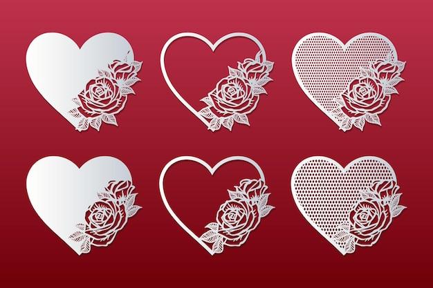 Set di cuori tagliati al laser con motivo a rose. cornici con rose. Vettore Premium
