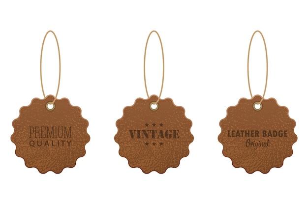 Set di etichette in pelle illustrazione su sfondo bianco Vettore Premium