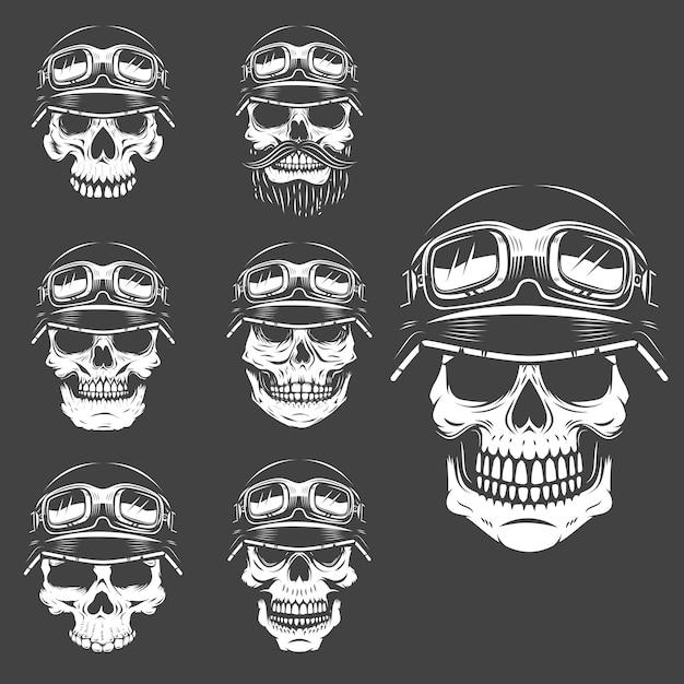 Set di teschi racer su sfondo bianco. elementi per logo, etichetta, emblema, poster, t-shirt. illustrazione. Vettore Premium