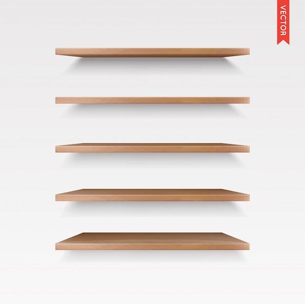 Set di ripiani in legno isolato sul muro Vettore Premium