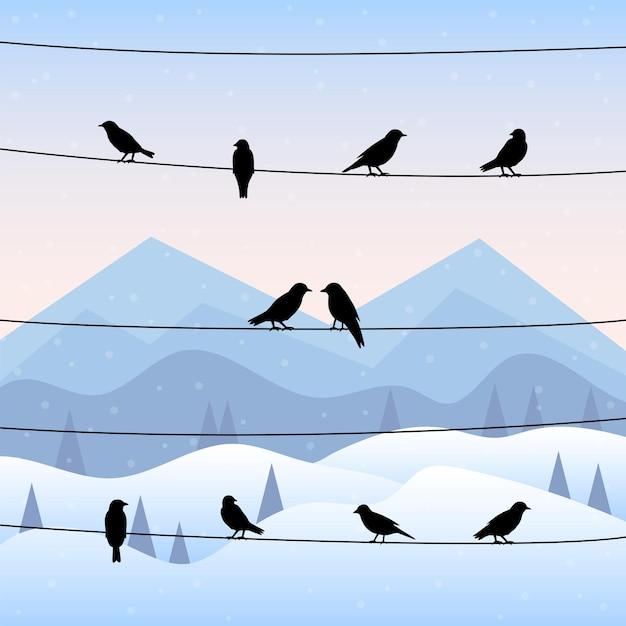 Siluetta degli uccelli sui fili nella priorità bassa di inverno. illustrazione vettoriale. Vettore Premium