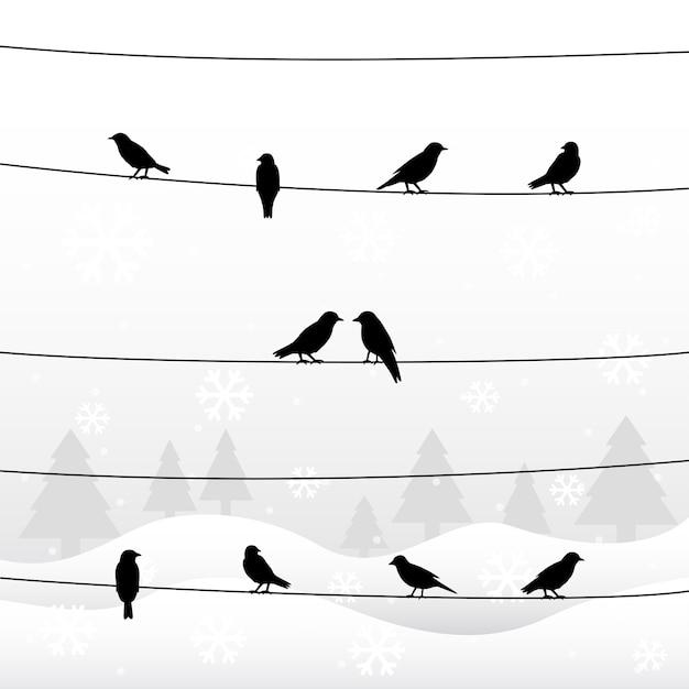 Sagoma di uccelli sui fili nella stagione invernale Vettore Premium