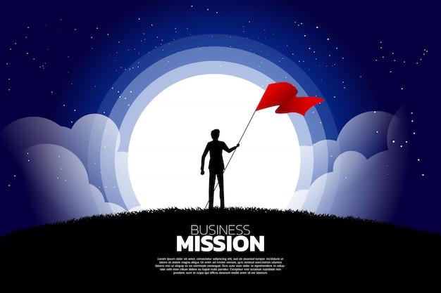 Siluetta dell'uomo d'affari con la bandiera che sta nella luna e nella stella. Vettore Premium