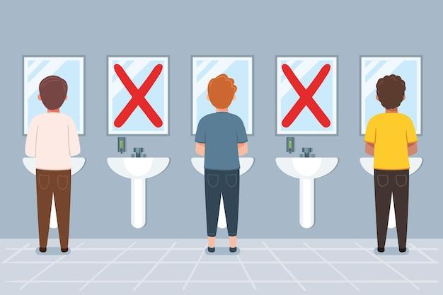 Distanza sociale nei bagni pubblici Vettore Premium