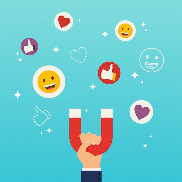 Concetto di marketing dei social media. magnete a mano che attira simpatie, cuori e faccine di reazione. Vettore Premium
