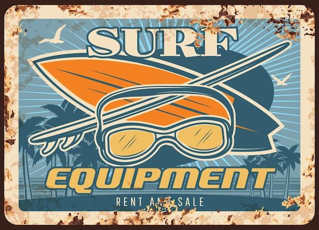 Attrezzatura da surf piastra metallica arrugginita con tavole da surf e maschera Vettore Premium