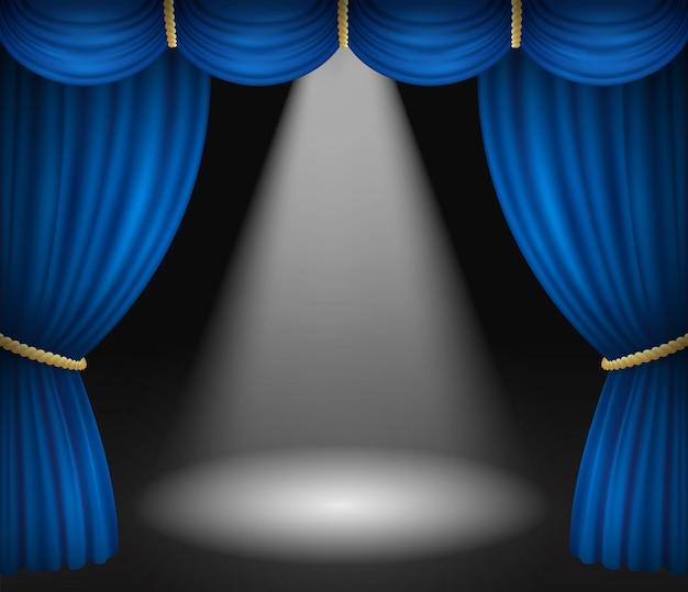 Palcoscenico con tende blu e riflettori Vettore Premium